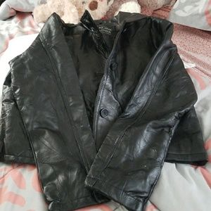 Cropped leather jacket patchwork detail